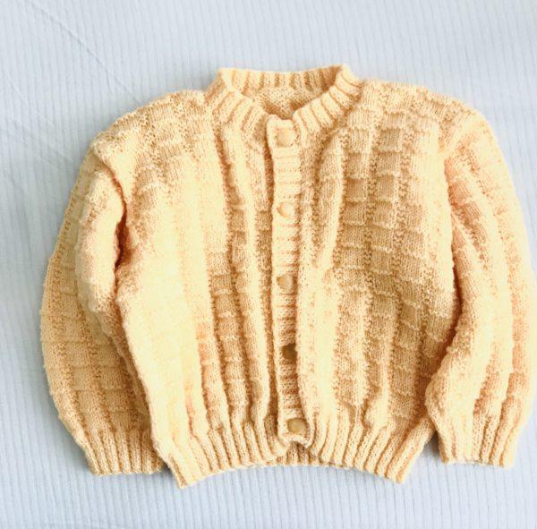 gilet enfant de deux ans tricoté à la main